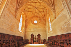 The magnificent chapel with a rows of oak chairs. The imposing medieval castle of the Knights Templar in Portugal. The magnificent chapel with a vaulted ceiling Royalty Free Stock Photos
