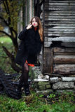 Magnificent charming gipsy colorful dress and fur coat dressed outdoor Royalty Free Stock Photography
