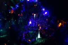 Of magnificent Christmas lights on a beautiful Christmas tree - Front view royalty free stock photo