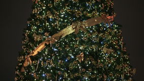 A magnificent Christmas tree, with flickering lights and Christmas decorations on Moscow`s city square at night. Close. Up New Year theme stock video footage
