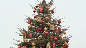A magnificent Christmas tree, sparkling with lights and beautiful ornaments on the square of Moscow. Close-up. New Year. A magnificent Christmas tree, sparkling stock video