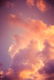 Magnificent colorful clouds in the evening sky. Bright, pink clouds in the sky at sunset. Beautiful evening skyscape. Abstract, pu. Rple pink background. Vibrant Royalty Free Stock Photography