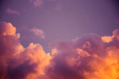 Magnificent colorful clouds in the evening sky. Bright, pink clouds in the sky at sunset. Beautiful evening skyscape. Abstract, pu. Rple pink background. Vibrant Stock Image