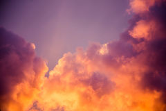 Magnificent colorful clouds in the evening sky. Bright, pink clouds in the sky at sunset. Beautiful evening skyscape. Abstract, pu. Rple pink background. Vibrant Royalty Free Stock Images
