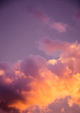 Magnificent colorful clouds in the evening sky. Bright, pink clouds in the sky at sunset. Beautiful evening skyscape. Abstract, pu. Rple pink background. Vibrant Stock Photography