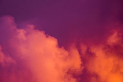 Magnificent colorful clouds in the evening sky. Bright, pink clouds in the sky at sunset. Beautiful evening skyscape. Abstract, pu. Rple pink background. Vibrant Royalty Free Stock Photo