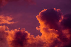 Magnificent colorful clouds in the evening sky. Bright, pink clouds in the sky at sunset. Beautiful evening skyscape. Abstract, pu Stock Images
