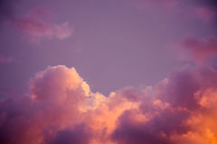 Magnificent colorful clouds in the evening sky. Bright, pink clouds in the sky at sunset. Beautiful evening skyscape. Abstract, pu Stock Image