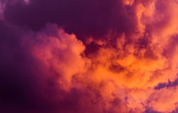 Magnificent colorful clouds in the evening sky. Bright, pink clouds in the sky at sunset. Beautiful evening skyscape. Abstract, pu. Rple pink background. Vibrant Stock Photos