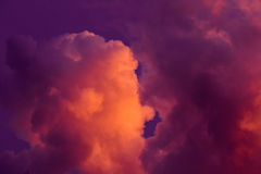 Magnificent colorful clouds in the evening sky. Bright, pink clouds in the sky at sunset. Beautiful evening skyscape. Abstract, pu Stock Photos