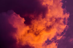 Magnificent colorful clouds in the evening sky. Bright, pink clouds in the sky at sunset. Beautiful evening skyscape. Abstract, pu Stock Photo