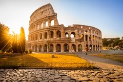 The magnificent Colosseum at sunrise, Rome, Italy, Europe. Colosseum at sunrise, Rome. Rome architecture and landmark. Rome Colosseum is one of the best known stock photography