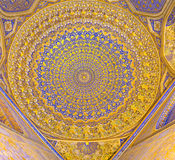 The magnificent cupola. SAMARKAND, UZBEKISTAN - APRIL 30, 2015: The cupola of mosque in Tilya Kori Madrasah is the masterpiece of the Uzbek art, on April 30 in royalty free stock photos