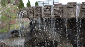 Magnificent decorative waterfalls with gold small. Fishes in tropical park Ukraine stock footage