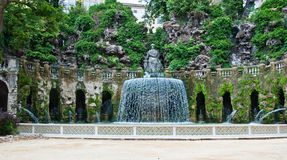 Magnificent fountain with a statue. Ancient magnificent italian fountain with a statue Stock Image
