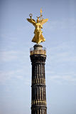 Magnificent Golden Statue. Photo Of A Magnificent Golden Statue On Top Of A Tower Royalty Free Stock Photography