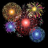 Magnificent graphics of multi-colored fireworks. On a dark background Royalty Free Stock Photos
