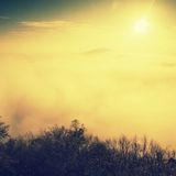 Magnificent heavy mist in landscape. Autumn fogy sunrise in a countryside. Hill increased from fog. Stock Images