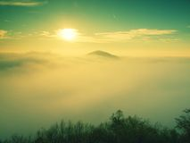 Magnificent heavy mist in landscape. Autumn fogy sunrise in a countryside. Hill increased from fog. Royalty Free Stock Photos