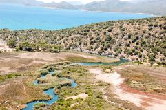 The magnificent landscape of a beautiful, winding mountain river flowing into the Mediterranean Sea. royalty free stock image