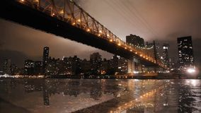 Magnificent low angle time lapse panorama view on night light illumination on modern Manhattan Brooklyn Bridge cityscape stock video footage