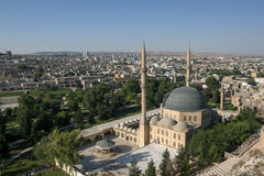 The magnificent Mevlid-i Halil Camii (mosque) in Urfa (Sanliurfa) in Turkey. In the background stands the modern city of Urfa Stock Images