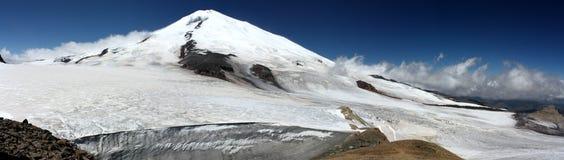 Magnificent Mount Elbrus. Mount Elbrus is an inactive volcano and the highest peak in the Caucasus mountain range, in Kabardino-Balkaria and Karachay-Cherkessia Stock Photos