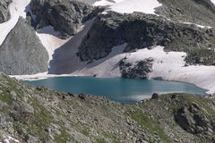 A  magnificent mountain lake surrounded by steep rocky slopes Royalty Free Stock Image