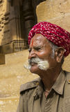 Magnificent moustaches of an old Rajasthani man at Jaisalmer For. Jaisalmer, Rajasthan, India - June 15, 2015: Portrait of a Rajasthani gatekeeper sitting Stock Images