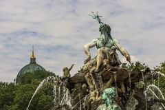 Neptune Fountain. One of the most iconic fountains in Berlin. The magnificent Neptune Fountain was originally designed by Reinhold Begas in 1891 and used to be Royalty Free Stock Photo