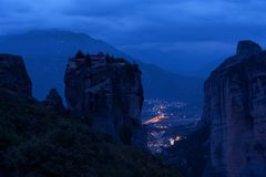 Magnificent night landscape. Monastery Holy Trinity, Meteora, Greece. royalty free stock photo