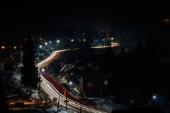 Magnificent night landscape of the Ukrainian village in bright light and blurred automobile lights royalty free stock photography
