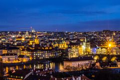 Beautiful Night view over the Vltava river, Charles bridge, the embankment Smetanovo, tower old city, Church St. Assisi. Magnificent Night view over the Vltava Royalty Free Stock Photos