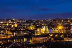 Beautiful Night view over the Vltava river, Charles bridge, the embankment Smetanovo, tower old city, Church St. Assisi. Magnificent Night view over the Vltava Royalty Free Stock Images
