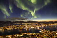 Magnificent northern lights above Tromso, Norway. Beautiful, massive northern lights aurora borealis above the city of Tromso, northern Norway Stock Photography