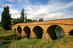 Magnificent old bridge. Old bridge built by convicts in the 1800's over a calm flowing river royalty free stock photos