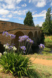 Magnificent old bridge. Old bridge built by convicts in the 1800's over a calm flowing river royalty free stock photography