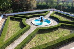 Magnificent palace labyrinth garden with fountain royalty free stock image