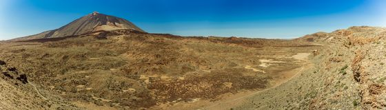 Magnificent panoramic view from the height at the edge of the mountain range around the volcano Teide. National park. Tenerife, stock photography