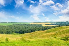 Magnificent pasture landscape and blue sky stock photography