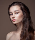 Magnificent portrait of a beautiful young woman with perfect skin closeup Stock Photography