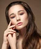 Magnificent portrait of a beautiful young woman with perfect skin closeup Stock Photo