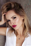 Magnificent portrait of a beautiful young woman with perfect skin and red lips. Stock Photo