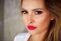 Magnificent portrait of a beautiful young woman with perfect skin and red lips closeup Royalty Free Stock Photo