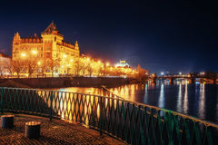 The magnificent Prague Castle at night along the River Vltava. Royalty Free Stock Images