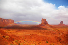 Magnificent rainbow in Monuments Valley. In reservation of Indians Navajo Royalty Free Stock Photo