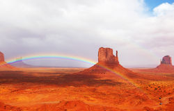 Magnificent rainbow in Monuments Valley Stock Images