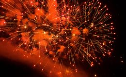 Magnificent red fireworks in the night sky Stock Photos