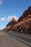 The magnificent  road passes between rocks Royalty Free Stock Images