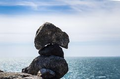 The magnificent rock statue on the coast stock photos